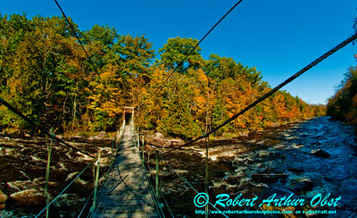 Boy scouts or hikers or paddlers enjoy blue skies and autumn colors along Boy Scouts Rapids on the wild Wolf River within northeastern Wisconsin and the Gardner Dam Scout Camp near White Lake (USA WI White Lake)