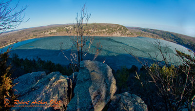 Hiker's view from West Bluff Trail of late day sun highlighting all of ice covered Devil's Lake and craggy bluffs within Devils Lake State Park (USA WI Baraboo; Obst FAV Photos 2013 Nikon D800 Destinations Wild Scenic Image 8819)