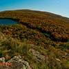 Blue skies and blazing autumn hardwoods and granite escarpments encircle Lake of the Clouds Scenic Area within Porcupine Mountains Wilderness State Park (USA MI Ontonagon)