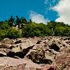 Hiker's view of clear blue skies over quartzite boulders and cliffs along Balanced Rock Trail within Devils Lake State Park (USA WI Baraboo)