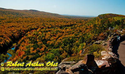 Hiker's view of blazing autumn hardwoods and granite cliffs bordering the Carp River within Lake of the Clouds Scenic Area and Porcupine Mountains Wilderness State Park (USA MI Ontonagon)