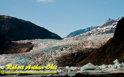 Hikers view of clear blue skies over Mendenhall Lake and Mendenhall Glacier within Tongass National Forest (USA Alaska Juneau)