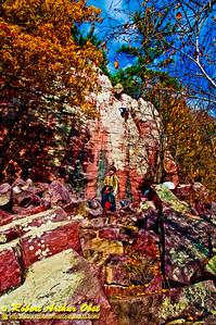Autumn beauty and colorful granite escarpments embrace hikers and rock climbers on Balanced Rock Trail within Devils Lake State Park (USA WI Baraboo)