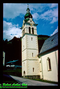 """Church clock tower within the Gail River Valley of Tyrol Austria (Europe Austria Tyrol Lienz Obertilliach Gail River Valley)"