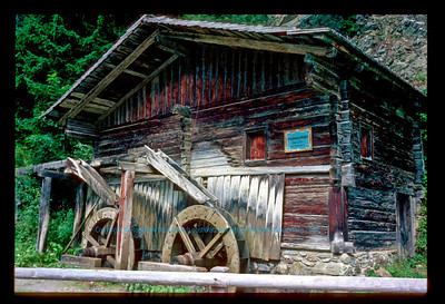 """Year built 1750 wooden water wheels used for agricultural power within the Gail River Valley of  Tyrol  Austria (Europe Austria Tyrol Lienz Obertilliach Gail River Valley)"
