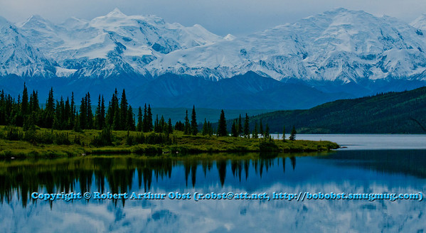 Hikers and bicyclers and bus riders view from Denali Park Road of majestic Mount Mckinley reflected in Wonder Lake within Denali National Park and Preserve (USA Alaska Denali Park; RAO 2011 Nikon D300 Image 0258)