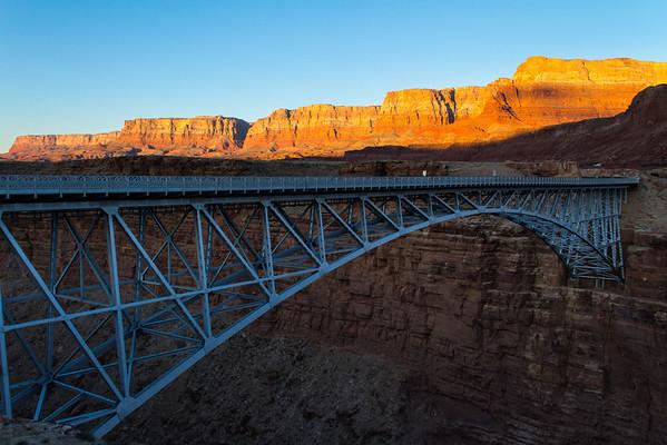 Navajo Bridge across the Colorado River; Vermilion Cliffs in the background.