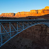 Navajo Bridge across the Colorado River; Vermilion Cliffs in the background.