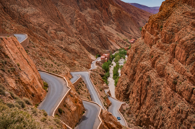 View looking down to multiple layers of wildly twisting road above the river in Morocco's dramatic Dades Gorge.