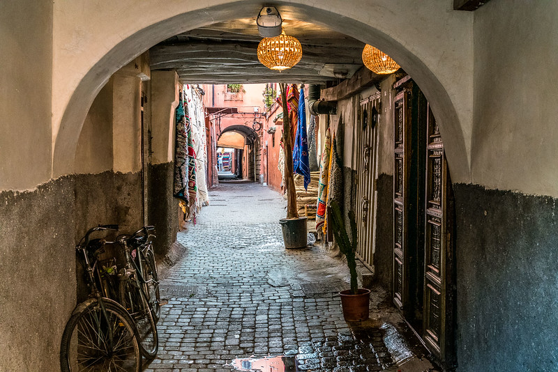 Arched alley leading deeper into the Medina