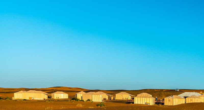 Merzouga Desert Luxury Camp as viewed from the dunes.