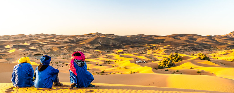 Bedouins gazing over the desert sunset.