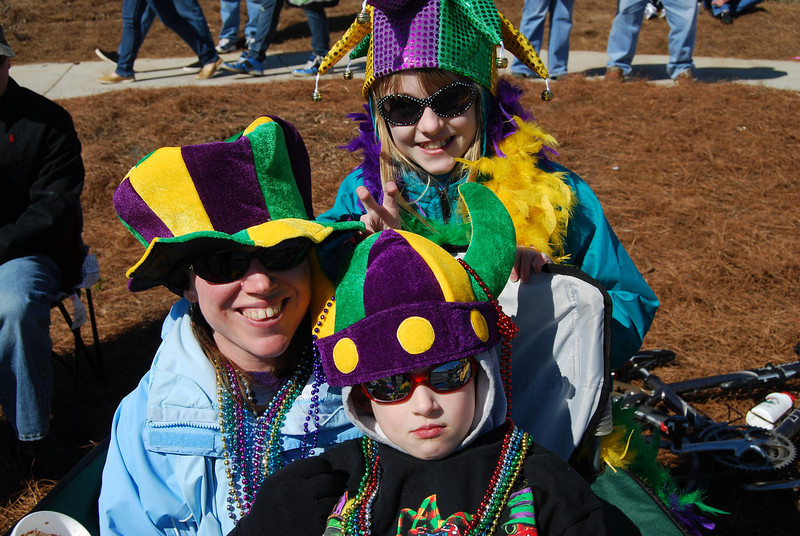 Anne, Andrew, and Laura are into Mardi Gras - better than the snow at home.