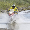 "Scott crosses some water off the Denali Highway.<br /> <br /> <a href=""http://www.motoquesttours.com/guided-motorcycle-tour.php?prudhoe-bay-motorcycle-adventure-tour-28"">http://www.motoquesttours.com/guided-motorcycle-tour.php?prudhoe-bay-motorcycle-adventure-tour-28</a>"