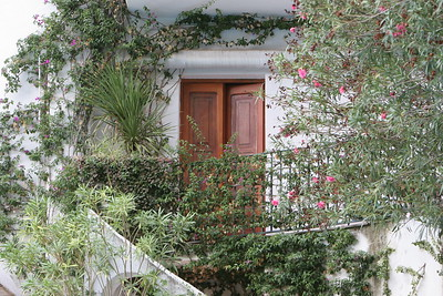 Beautiful hand crafted wooden doors framed with the lush vegatation of the Amalfi Coast