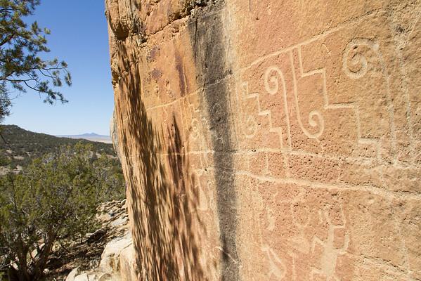 Petroglyphs on south-facing wall of sandstone ridge.