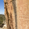 Petroglyphs on south-facing wall of sandstone ridge.