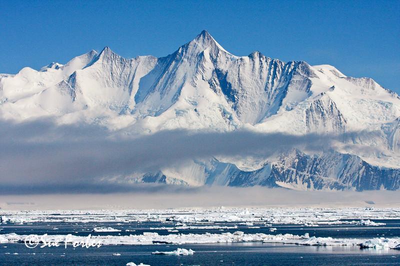 Mt Herschel<br /> Mt Herschel 3,335m (10,942ft) high.  It rises almost vertically straight out of the Ross Sea, Antarctica