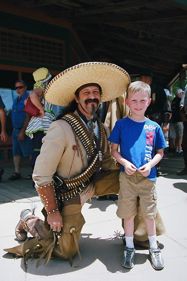 Kyle was frightened by the cowboys in Tombstone. I asked for one picture and my only stipulation was that he find the meanest, baddest, toughest cowboy in the place. As we were leaving, he ran across this fellow. I think he did a fine job.