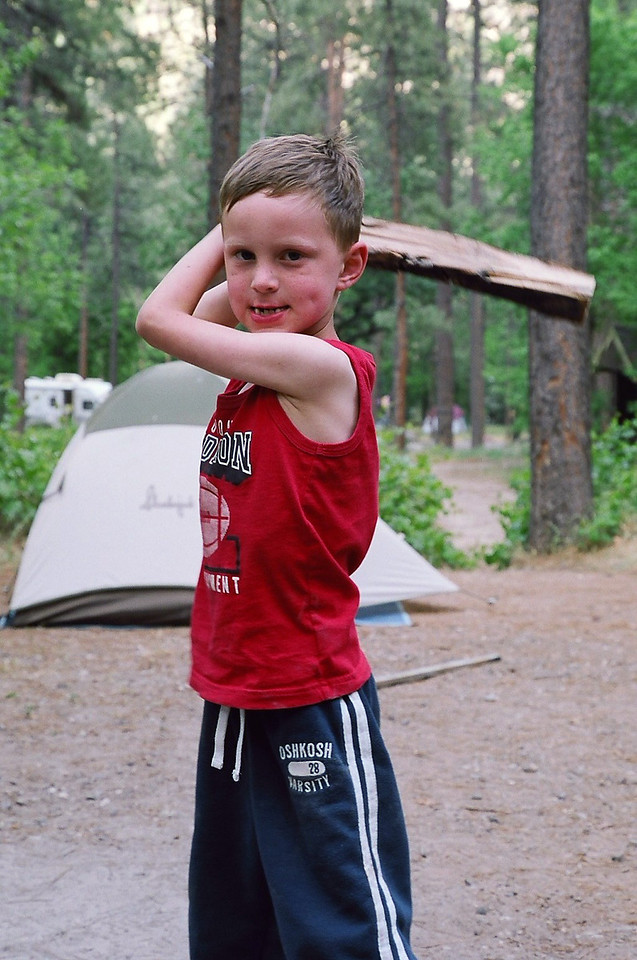 Kyle pretending to whack me with a log at Cave Springs Campground, Sedona, Arizona. May 2013.