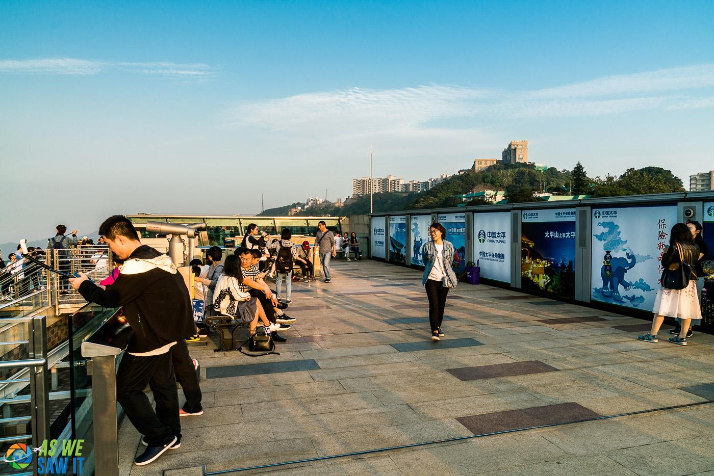 People on viewing platform atop Victoria Peak in Hong Kong