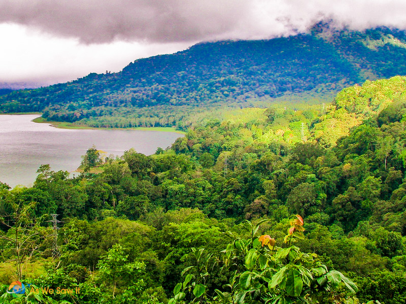 Clouds hang low over a lake, Bedugul Bali. Mountain in background