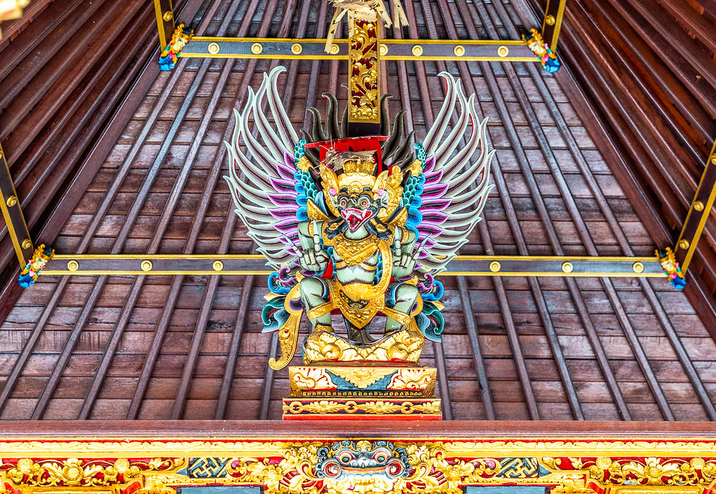 Colorful sculpture of a garuda, legendary bird-like creature in Balinese religion.