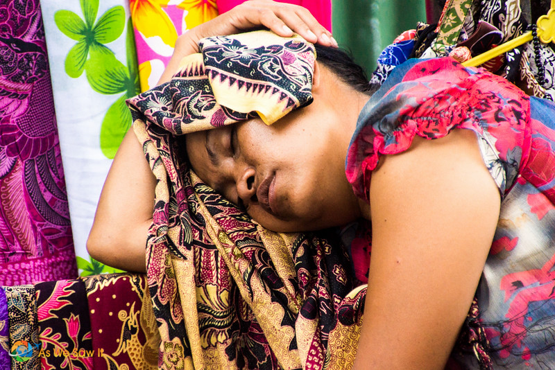 Women vendor sleeping in her shop at the Ubud Market in Bali