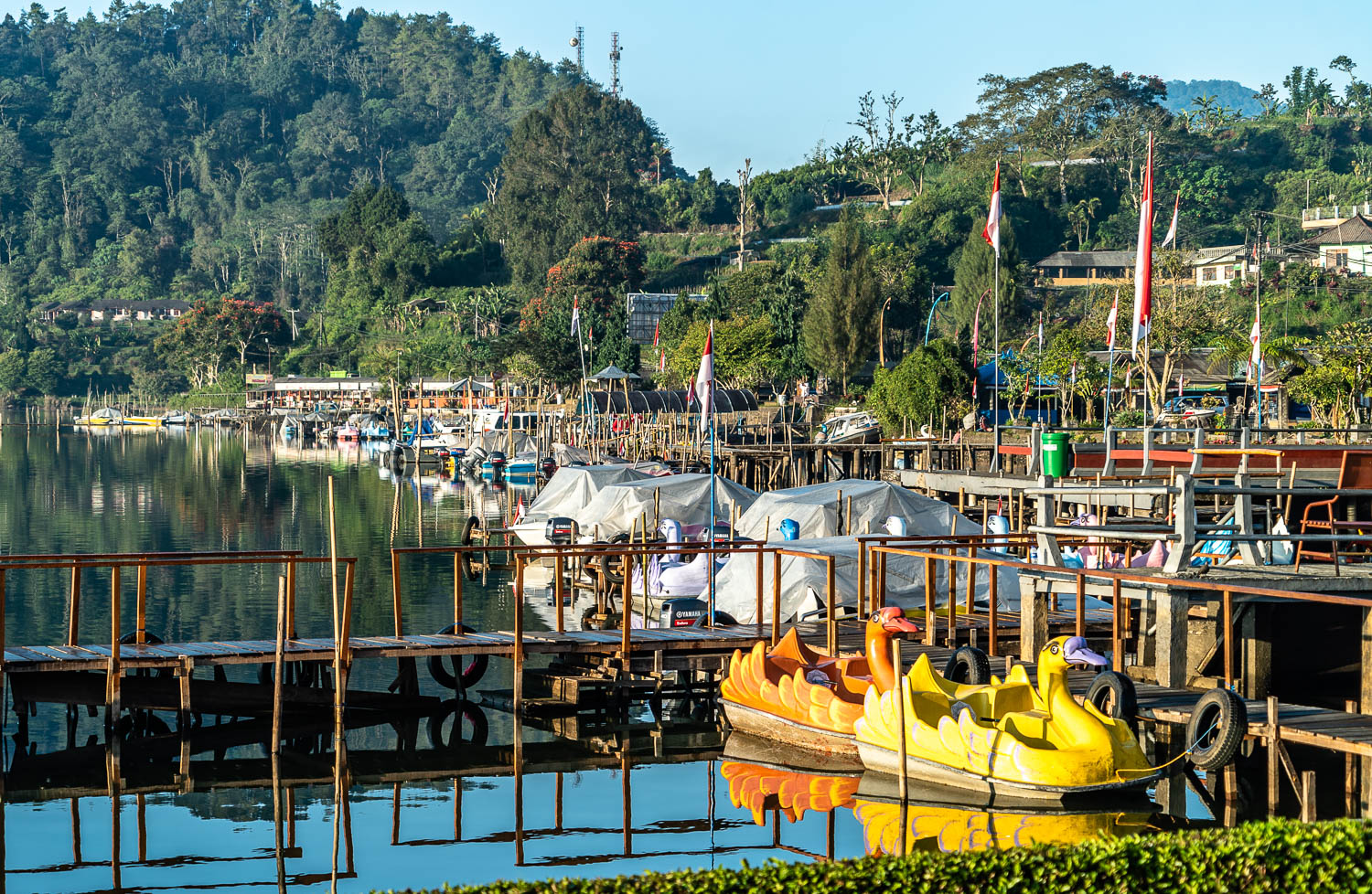 Marina at Ulun Danu Bratan, with a row of boats where visitors can get an up close view of the temples from the water.