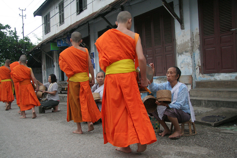 Locals giving alms.