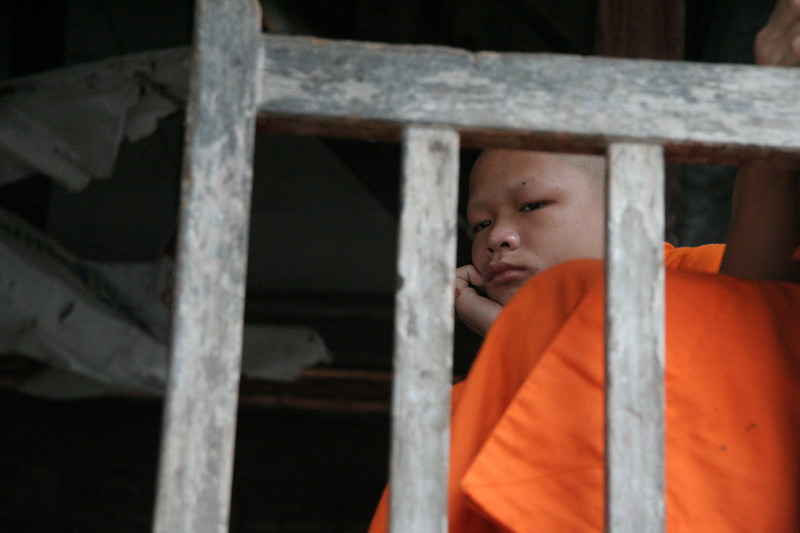 Young monk waiting to start the processional