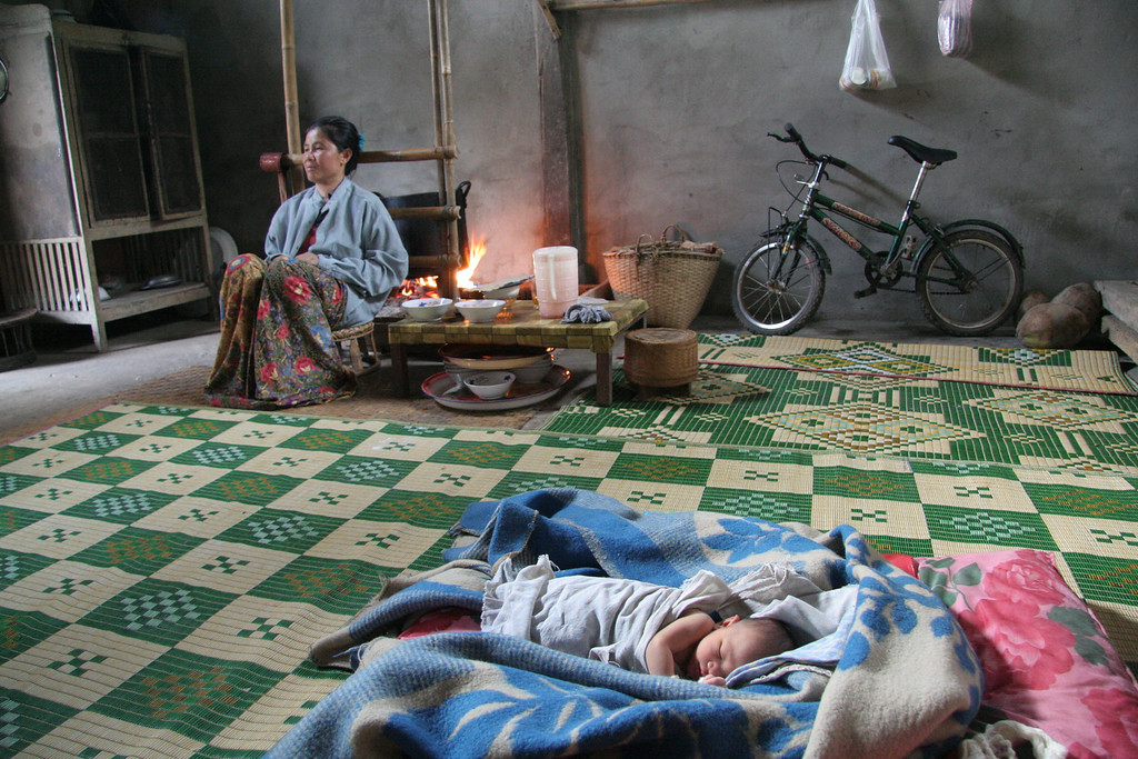 Mother and baby.  The mother was sitting by the medicinal fire recooperating from her labor.