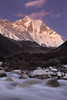 """Lhotse Dreams II""<br /> <br /> This is an image from the Khumbu region of Nepal. After a day of exploring in the Dingboche area I scrambled down to the banks of the Imja River to watch the last light on Lhotse, the world's 4th highest mountain at 8,516m. I found a composition I liked and took several photographs of the last light on the peak, but as was often the case on that trip I ended up preferring the dusk shots. A perfect evening in the land of the giants. I was amazed at how long the alpenglow lingers on those Himalayan faces. Lhotse from Dingboche, Nepal."