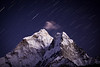 """Himalayan Skies XXII""<br /> <br /> This is the stunning west face of Ama Dablam, viewed from the hills above Dingboche, in the Khumbu region. Again I was mesmerized by the lingering alpenglow on this Himalayan icon, and proceeded to take several exposures of the fluted peak and its perennial little cloud. This was one of my favourite shooting locations of the entire trip. The giants were at their best that night. Ama Dablam, Nepal."
