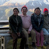 Family that ran the guest house sits with Dad and Bishnu