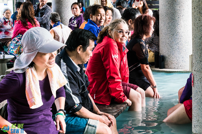 People soaking feet in the water at Beitou Hot Springs