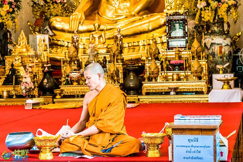 Monk inside wat traimit near chinatown, bangkok