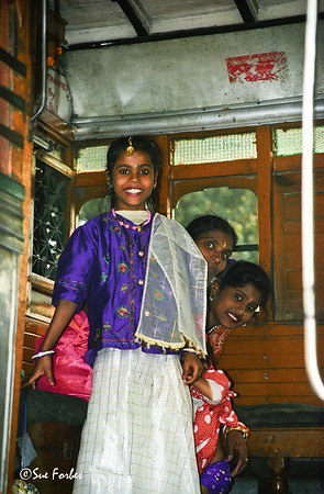 Girl on bus in Calcutta Girl all dressed up on a bus in Calcutta, India