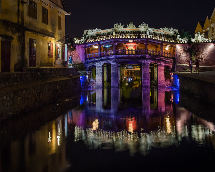 Night view of ancient Japanese bridge with lights in Hoi An Vietnam