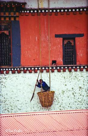 Paro Dzong Cleaning Paro Dzong walls, Bhutan