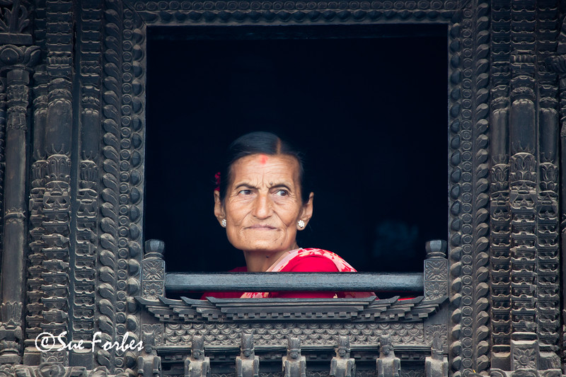 Woman watching the Indra Jatra Festival, Durbar Square, Kathmandu, Nepal