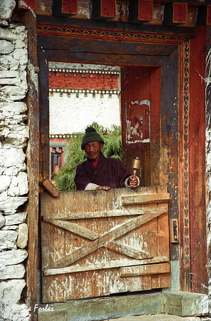 Jambay Lhakhang Monastery, Bhutan Man at Jambay Lhakhang, oldest monastery where buddhism started in 7th century, Bhutan