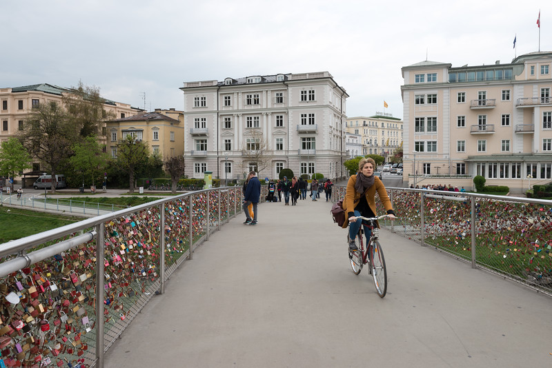 Makartplatz Bridge (Love Lock Bridge), Salzburg, Austria.<br /> <br /> A love lock or love padlock is a padlock which sweethearts lock to a bridge, fence, gate, or similar public fixture to symbolize their love. The Makartsteg is a bridge over the Salzach River in Salzburg′s city centre which is full of these love locks. The bridge is named after the 19th century Historicist painter Hans Makart, who was born and raised in Salzburg. Makart became famous as a painter of the Viennese Historicism, providing artwork for many of the pompous buildings of the Ringstraße. The Makartsteg is open for pedestrians and cyclists only.