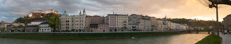 Panoramic view of Salzburg, with the river Salzach in the foreground in the late evening hours.