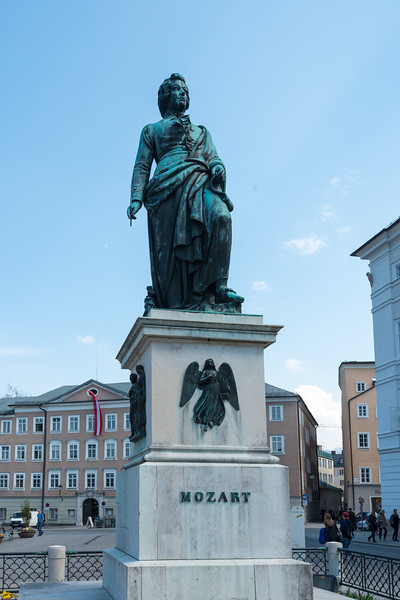 Mozartplatz & Mozart Monument, Salzburg, Austria. The square is dominated by the statue of Mozart by Ludwig Schwanthaler, ceremoniously unveiled on September 5, 1842 in the presence of Mozart's sons. Mozart's widow, Constanze von Nissen, did not live to see the unveiling. She died on March 6th of the same year in the house at Mozartplatz 8. A plaque was placed on the house in her memory.