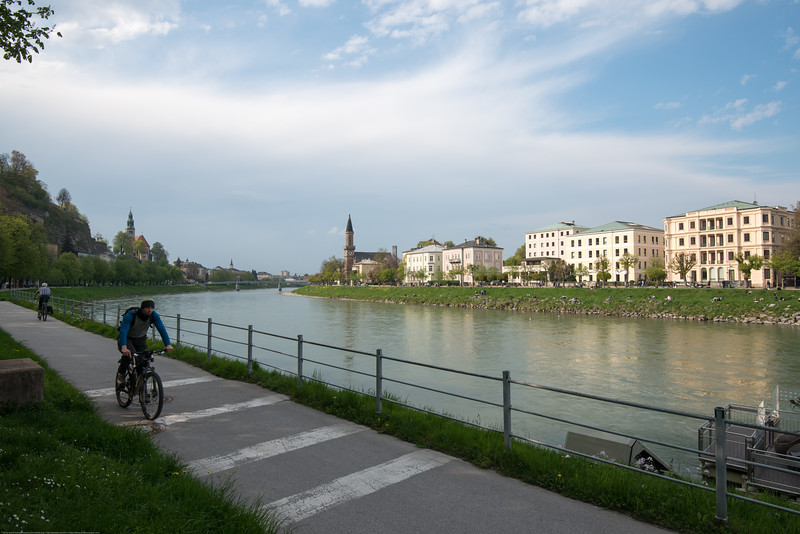 Cycling parallel to the Salzach river is very popular in Salzburg, Austria.