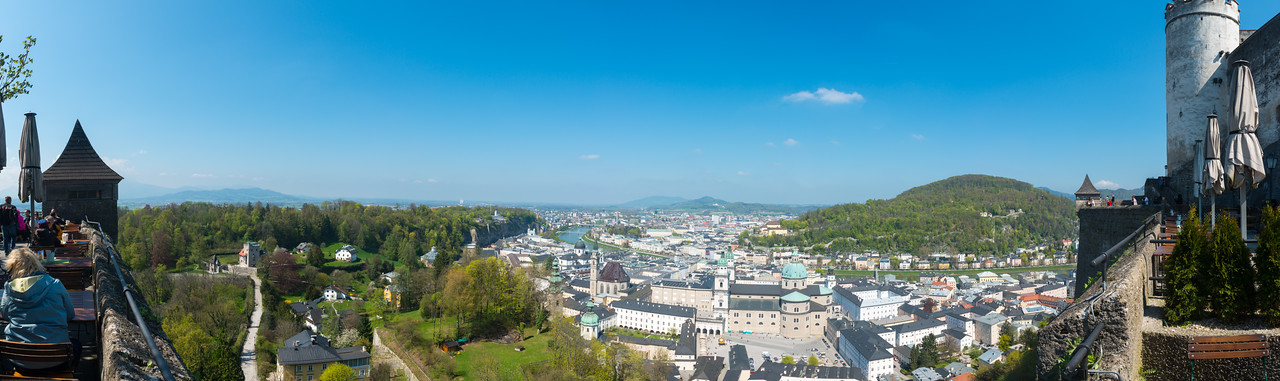 Salzburg panorama as seen from the Cafe at Hohensalzburg Castle. Hohensalzburg Castle sits atop the Festungsberg, a small hill in the Austrian city of Salzburg. Erected at the behest of the Prince-Archbishops of Salzburg.