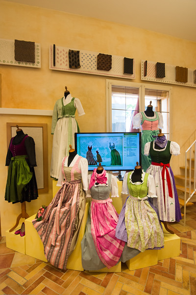 Women stitching and selling various cloth and garments at the Salzburg Museum.