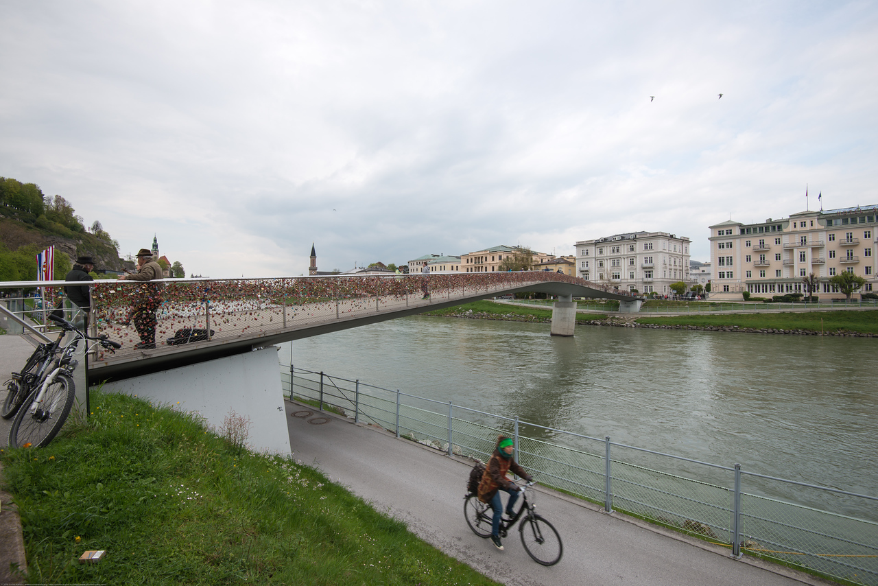 Cycling along the Salzach river is very popular in Salzburg, Austria.