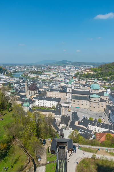 Salzburg viewed from the Festung Hohensalzburg. Kapitelplatz (Chapter Square) in Altstadt, and the funicular can be seen below Hohensalzburg Fortress. Salzburg, Austria.